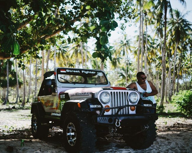 ASIA Atv Cool Guy Day INDONESIA Jeep Land Vehicle Maluku  Man Mode Of Transport Moluccas Morotaiisland Palm Trees Posing Shadow Transportation Travel Tree Tropical The Portraitist - 2017 EyeEm Awards Connected By Travel