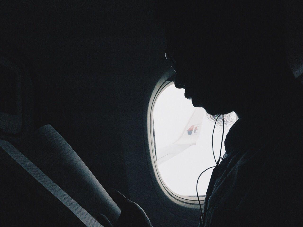 MAN SITTING IN AIRPLANE