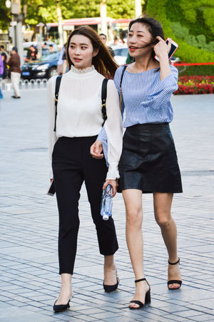 Casual Clothing Day Front View Full Length Leisure Activity Lifestyles Outdoors Real People Standing Two People Walking Young Adult Young Women