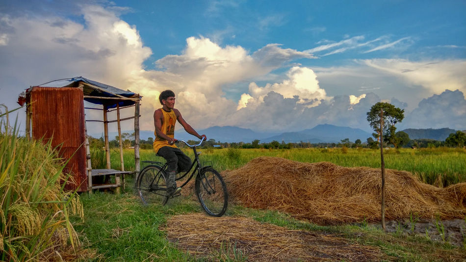 Adult Adults Only Adventure Beauty Beauty In Nature Bicycle Cloud - Sky Cycling EyeEmNewHere Field Grass Landscape Mountain Nature One Person Outdoors Paddy Field Rural Scene Sky Sunlight Transportation Vacations The Secret Spaces The Street Photographer - 2017 EyeEm Awards The Great Outdoors - 2017 EyeEm Awards The Portraitist - 2017 EyeEm Awards The Photojournalist - 2017 EyeEm Awards