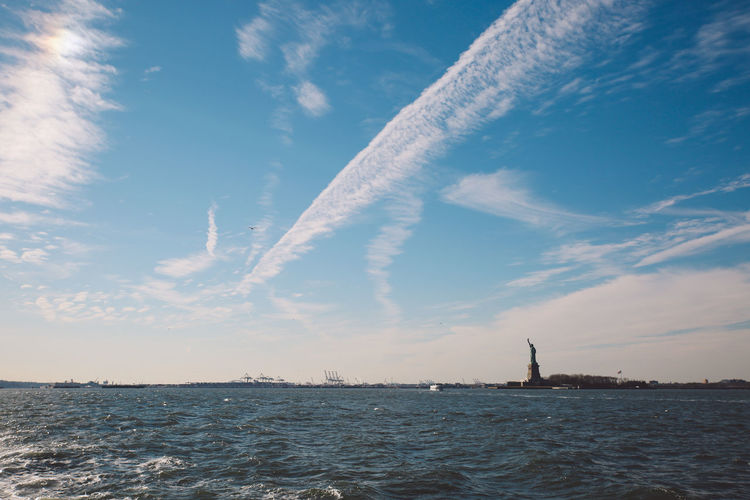 Cloud - Sky Day Ferry Nature Nautical Vessel New York New York City No People Outdoors Sailboat Sea Sky Staten Island Ferry Statue Of Liberty Sunny Travel Destinations Urban Skyline Water Winter