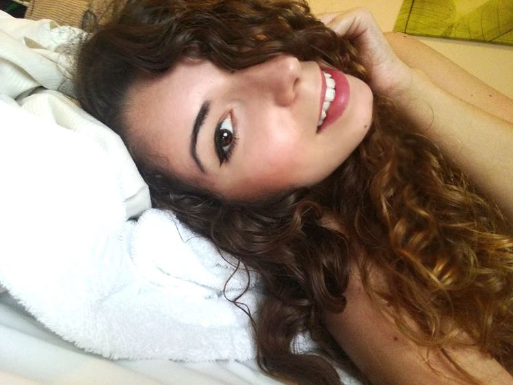 Portrait Beautiful Woman Beauty Beautiful People Looking At Camera Young Women Smiling Lying Down High Angle View Close-up Pink Lipstick  Wavy Hair Natural Beauty Eyeliner Fashion Model Curly Hair Eyelash
