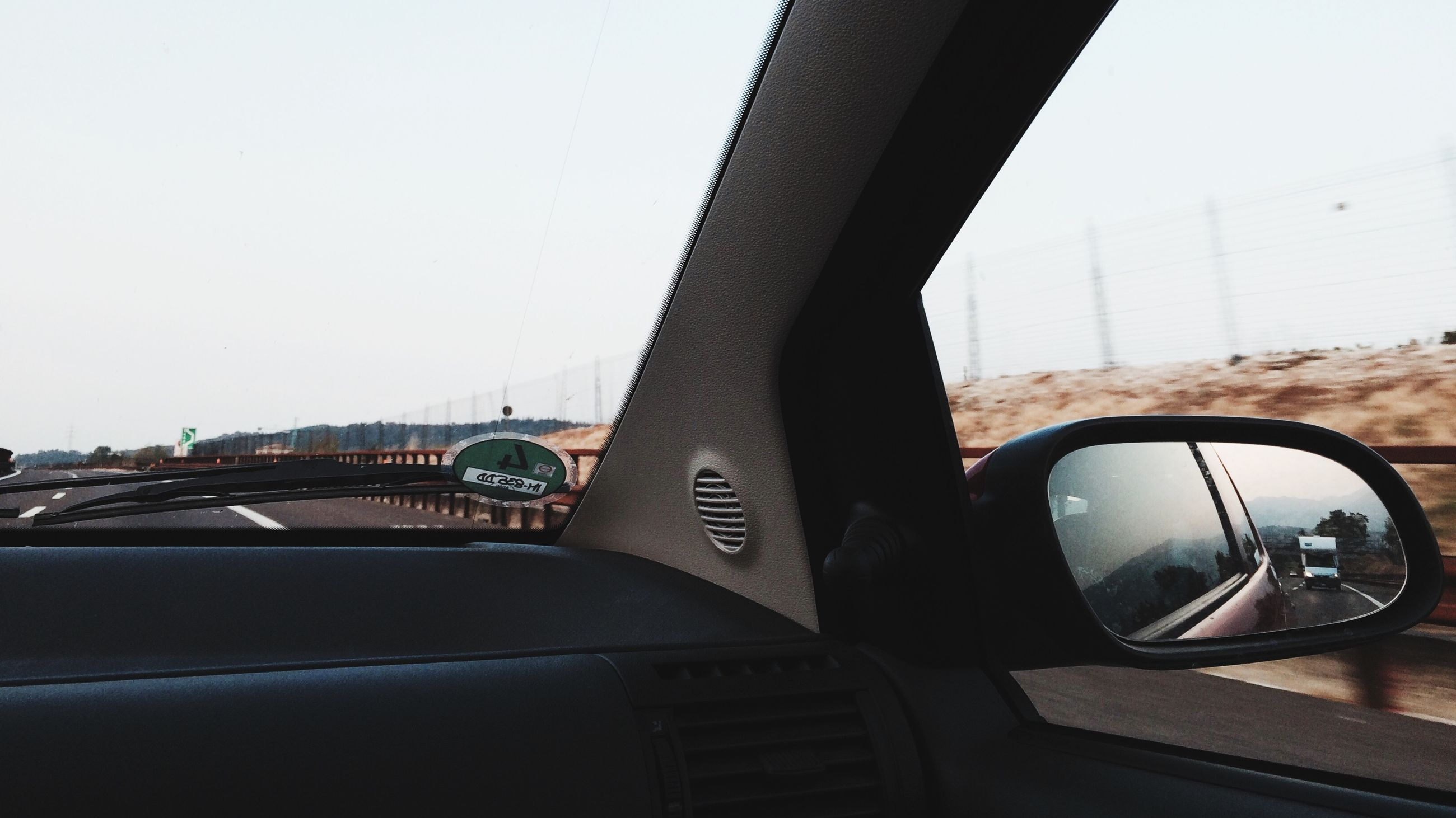 transportation, mode of transport, architecture, built structure, clear sky, car, land vehicle, bridge - man made structure, connection, building exterior, part of, copy space, cropped, sky, engineering, city, road, window, day, travel