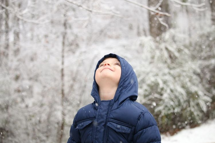 snow! Fun Happy New Experience Snow Young Boy Child Looking Up At Snow EyeEm Selects Winter Cold Temperature Snow Hiking One Person Headshot Forest Day Nature Beauty