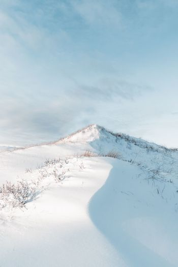 Beauty In Nature Tranquility Nature Environment Scenics - Nature Sky Snow No People Cold Temperature Land Outdoors Cloud - Sky Non-urban Scene Blue Frozen Snowcapped Mountain Tranquil Scene Landscape Winter Day