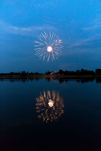 Nightphotography Arts Culture And Entertainment Celebration Cloud - Sky Event Exploding Firework Firework - Man Made Object Firework Display Illuminated Lake Long Exposure Motion Nature Night No People Outdoors Reflection Sky Water Waterfront