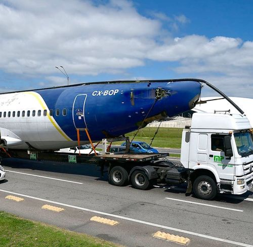 Plane transport Transportation Mode Of Transportation Land Vehicle Road Sky Cloud - Sky Air Vehicle Day Travel Stationary Airplane Airport Nature Motor Vehicle Truck Outdoors No People Business White Color Freight Transportation