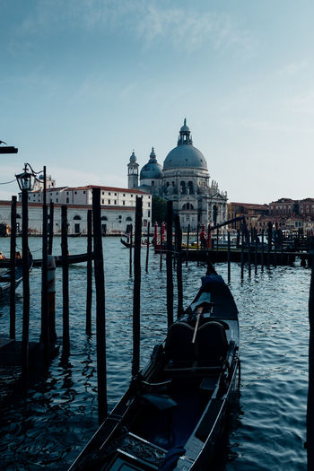 Gondolas moored at port against st mark cathedral