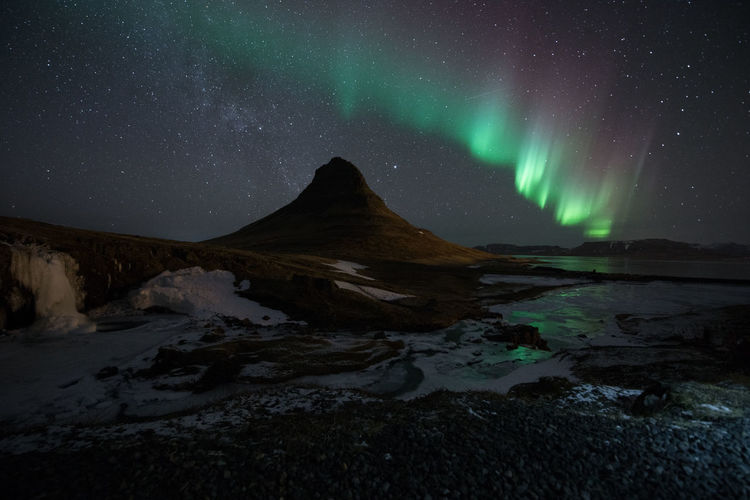 Northern Light Aurora borealis at Kirkjufell Iceland with fully star in the sky Iceland Kirkjufell Northern Lights Astronomy Beauty In Nature Idyllic Mountain Nature Night No People Non-urban Scene Scenics - Nature Sky Space Star - Space Tranquil Scene Tranquility Water