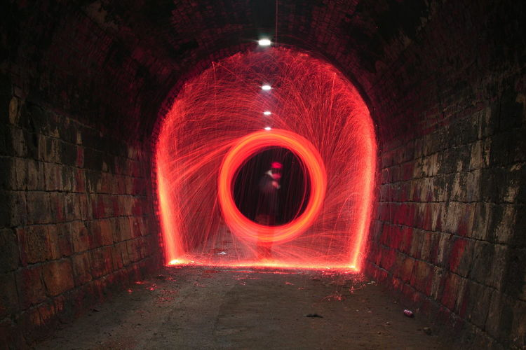 Red Wire Wool Spinning In Tunnel At Night
