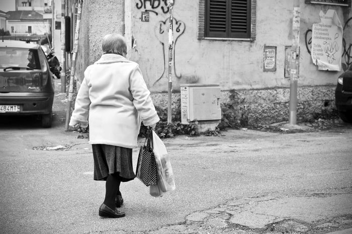 BeW Adult Architecture Bianco E Nero Black And White Building Exterior Built Structure Carrying Child City Day Full Length Lifestyles Men One Person Outdoors Pigneto Real People Rear View Road Street Transportation Walking Walking Cane Women