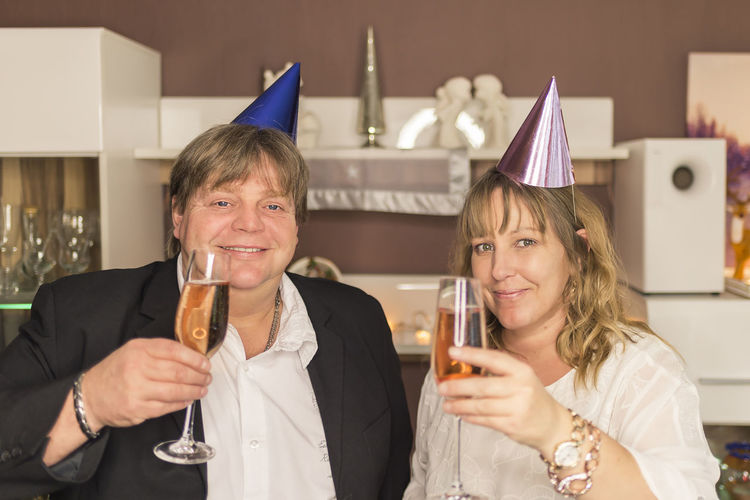 Close-up portrait of couple drinking champagne at party