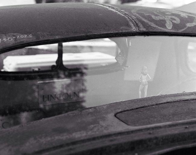 Girl in the window. PENTAX67 Kodak Tri-X 400 Film Car