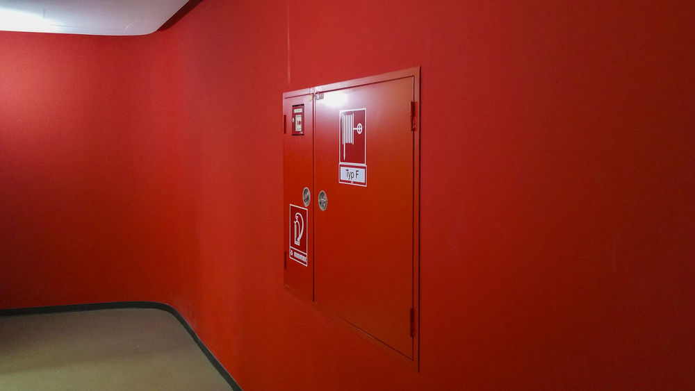 RedWall Absence Ankelmannsplatz Close-up Closed Day Der Bogen Empty Fire Alarm Box Floor Handy Photo Illuminated Modern Architecture No People Red Red Wall Staircase Teherani Building