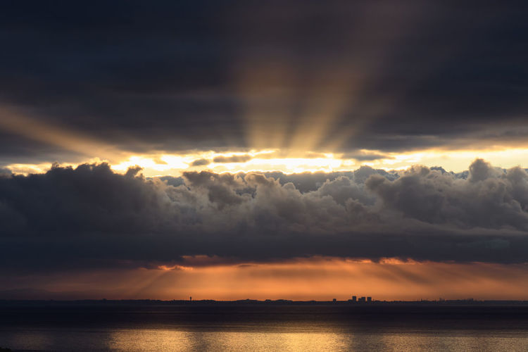 Dramatic sunrise over the Los Angeles skyline with light rays Sky Cloud - Sky Beauty In Nature Scenics - Nature Sunset Water Tranquility Sunbeam Tranquil Scene Idyllic Sunlight Waterfront Nature Sea No People Sun Dramatic Sky Orange Color Outdoors