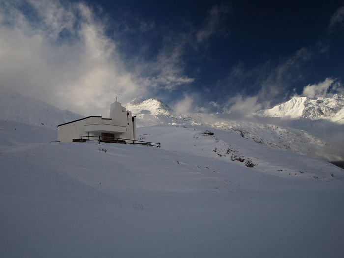 Church at Ospizio del Lucomagno, altitude 1920m Church Cloud Cold Temperature Day Environment Mountain Mountain Pass Nature No People Outdoors Sky Snow Travel Winter