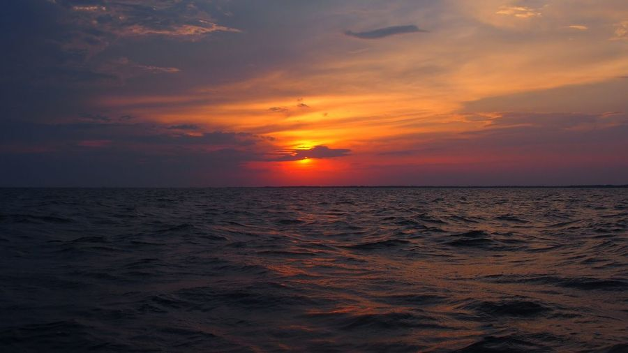 Sky Sunset Sea Water Beauty In Nature Scenics - Nature Horizon Over Water Horizon Tranquil Scene Tranquility Orange Color Land Wave Nature