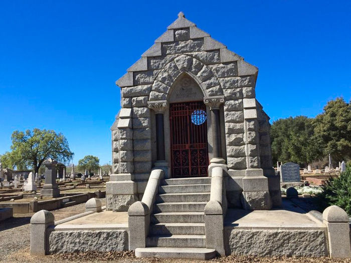 Historic Marysville Cemetery Architecture Blue Building Exterior Built Structure California Cemetary Clear Sky Cross Crypt Day Entrance Façade Low Angle View Marysville, Outdoors Religion Shadow Spirituality Sunlight Tree