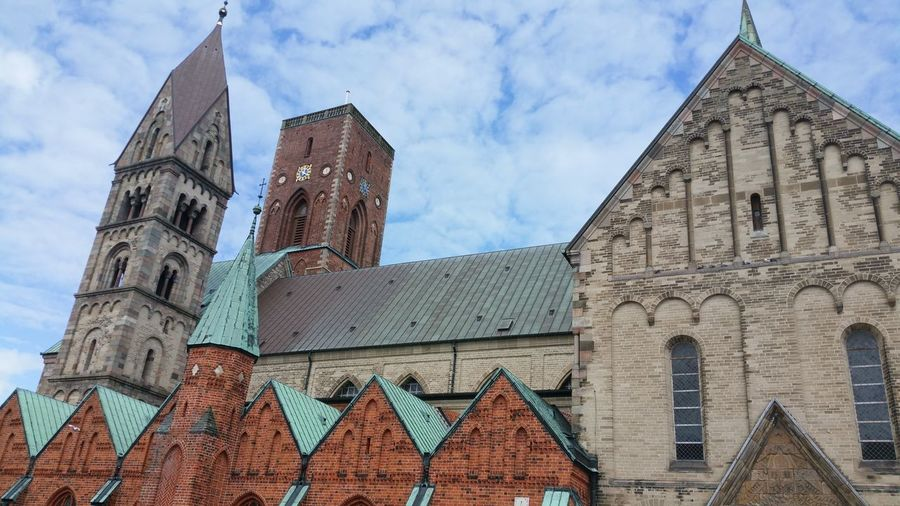 One church...different bricks Architecture Travel Destinations History Building Exterior Built Structure No People Outdoors Wall Dänemark Denmark Danmark Ribe Architecture Brick Wall House Tower Church Kirche Kirke Clouds And Sky EyeEm Selects