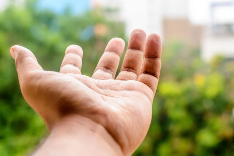 Close-Up Of Human Hand Gesturing Outdoors