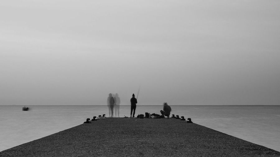 Longexposure Landscape Seascape Fishing Monochrome Morning Sea Water Sky Horizon Horizon Over Water Real People Lifestyles Men Beach Scenics - Nature Beauty In Nature Nature Day Women Outdoors Land Clear Sky