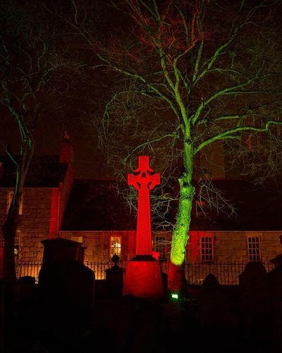 Eerily Beautiful Illuminated stone cross at St. Nicholas Kirk was looking eerily beautiful at Spectra 2016, with lighting, smoke and lasers, stunning. @visitabdn SpectraABDN Spectra2016 Eery Beautiful Cross Stone Tree Illumination Peaceful Nature Graveyard Stunning Minimalist Kirk Kirkofstnicholas Aberdeen Church Visitabdn VisitScotland