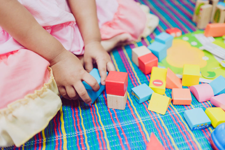 Close-up of girl playing with toy