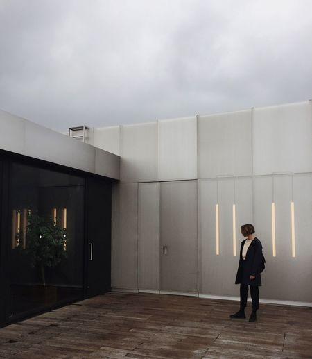 Full length of man walking in illuminated building