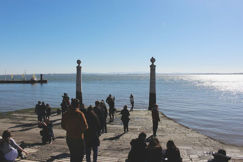 Water Real People Sky Outdoors Silhouette Day Clear Sky Scenics Vacations Men Women People Adult Horizon Over Water Large Group Of People Lisboa Lisbon Portugal Cais Das Colunas Travel Travel Destinations Tourism Adapted To The City Miles Away