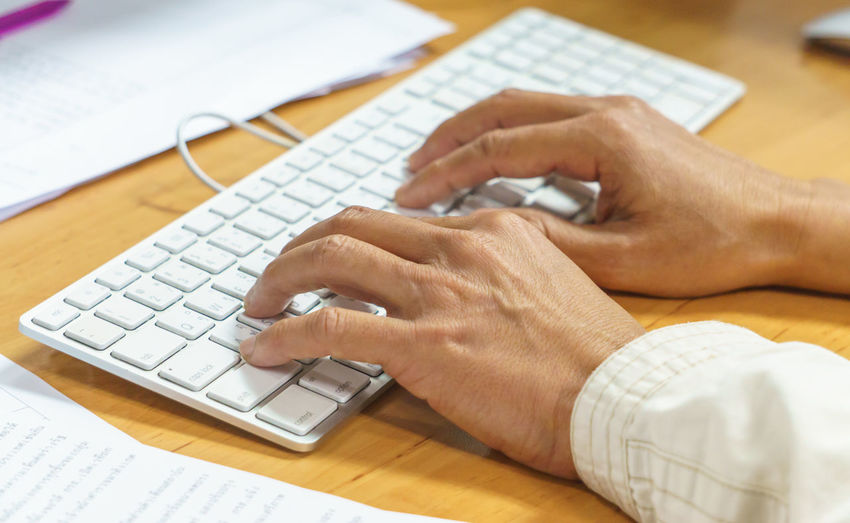 hand typing keyboard computer. Body Part Close-up Communication Computer Computer Equipment Computer Key Computer Keyboard Connection Finger Hand Human Body Part Human Hand Indoors  Keyboard Laptop One Person Real People Surfing The Net Table Technology Typing Using Computer Using Laptop Wireless Technology