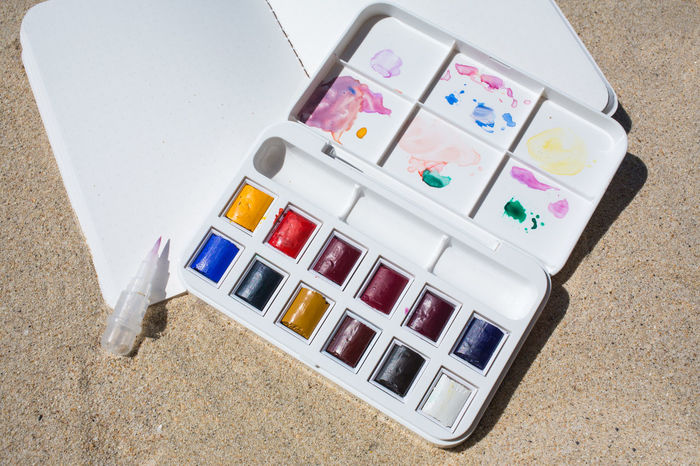 Notebook & Watercolor box on beach background Artist Box Colors Creativity PaintBox Rainbow Colors Textured  Travel Backgrounds Beach Brush Close-up Colorful Decoration Drawing Hobby Multicolors  Notebook Paintbrush Painting Plastic Sand Thailandtravel Watercolor Watercolor Painting