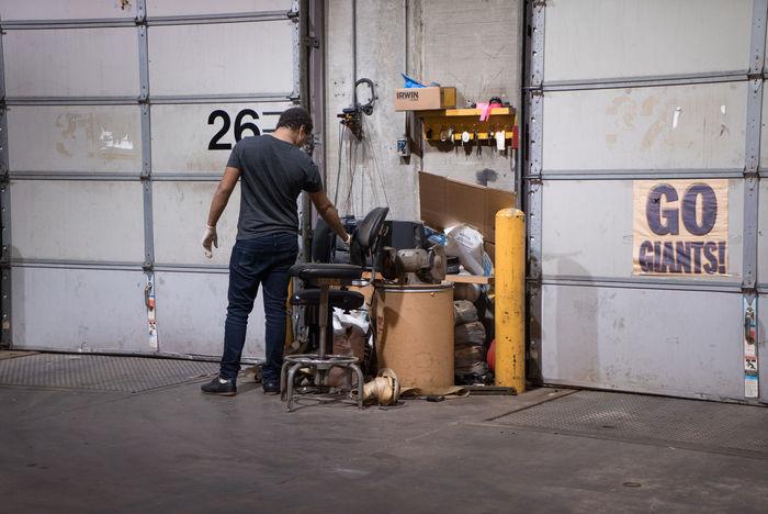Bronce Car Dirty Garage Door Lighting Mechanic Messy Mode Of Transport Moody New Jersey Porsche Radio Repairing Repairs Station Transportation Warm Working