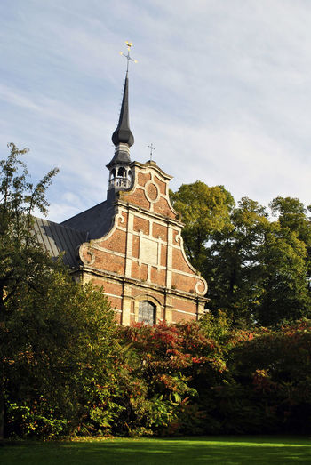 Architecture Autumn Beguinage Building Exterior Built Structure Business Finance And Industry Church Clock Clock Tower Day Leuven Leuven, Belgium No People Outdoors Religion Sky Travel Travel Destinations Tree Vertical