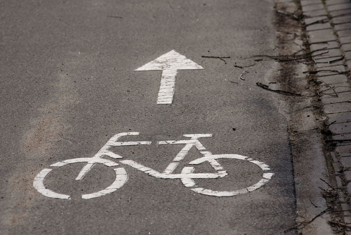 Bicycle road sign on asphalt. Asphalt City Sign Traffic Asphalt Road Bicycle Bicycle Road Direction No People Road Road Sign Transportation