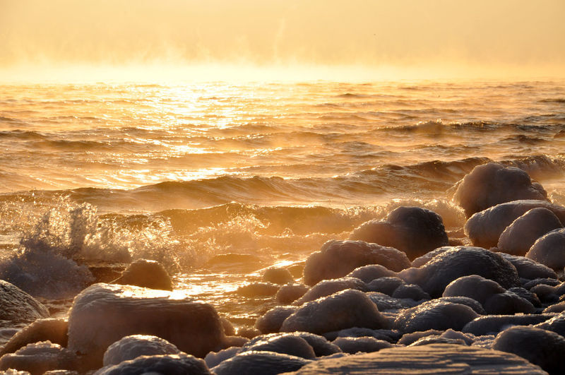 Scenic View Of Frozen Rock Formations In The Baltic Sea At Sunset