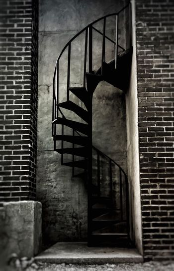 Spiral staircase going down, paint your body red and brown. K.O.L Spiral Staircase Black & White