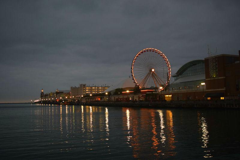 Illuminated Ferris Wheel At Navy Pier In Sea Against Sky