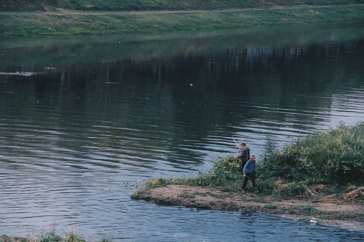 2 men fishing at Arno river in FI, Italy Water Leisure Activity Adult Men People Beauty In Nature Photowalk Fishing Fishing Life Arno River Italy Outdoor Activity Street Photography