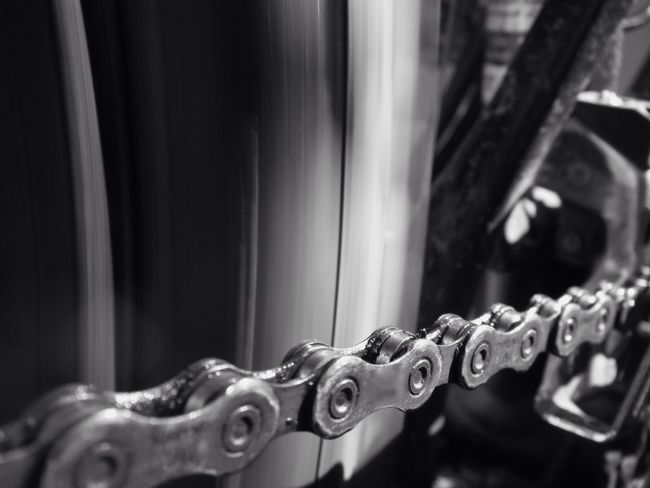 spinning wheel and a grimy drivetrain Chain Bicycle Chain Machinery Moving Parts Links Black And White Blackandwhite Metal No People Close-up No Budget Photography