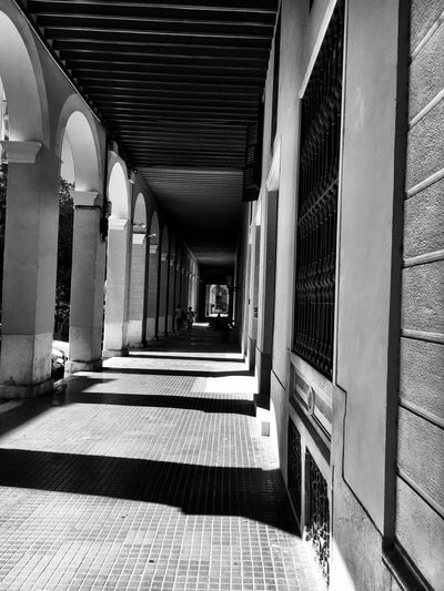 Sun and shadow EyeEm Selects Architecture Built Structure Sunlight Shadow Day No People Direction Architectural Column Building Arcade Corridor Flooring Railing Pattern