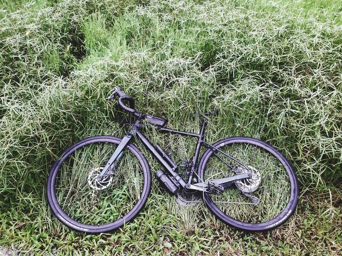 High angle view of bicycle parked on field