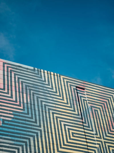 Low Angle View Sky Architecture Building Exterior Built Structure Blue Nature No People Pattern Day Building Sunlight Outdoors Cloud - Sky Copy Space City Business Office Wall - Building Feature