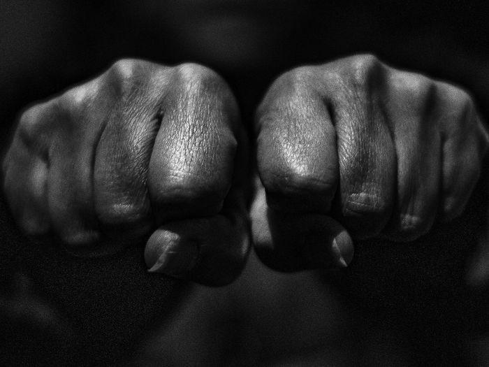 Close-up of fist in darkroom