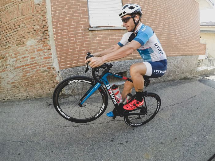 Training Cycling Gopro Wheelie Bicycle Transportation Real People One Person Glasses Full Length Lifestyles Leisure Activity Casual Clothing Men Riding Sunglasses Ride Day Activity Mode Of Transportation Fashion City Street Outdoors