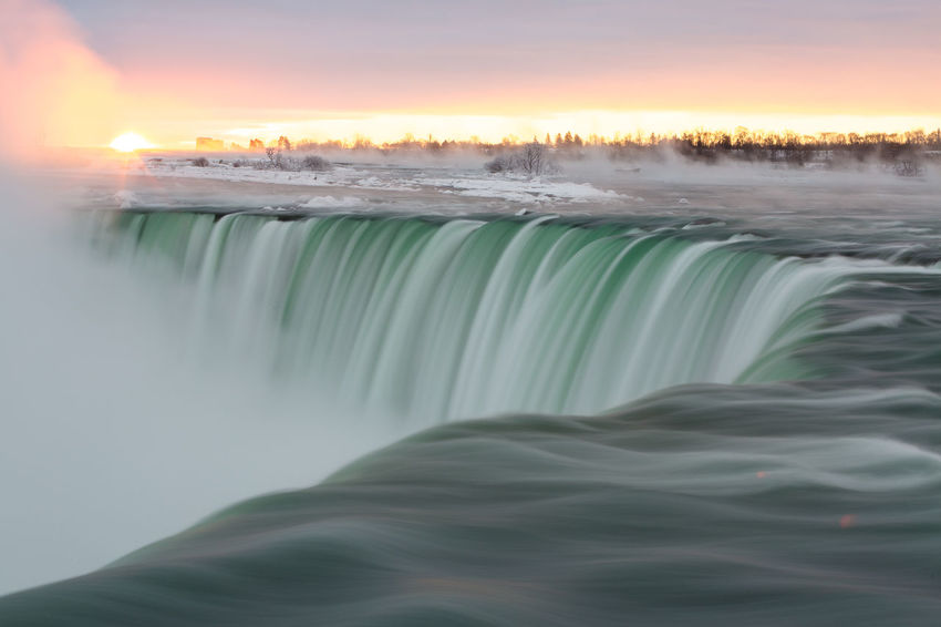 The Horseshoe falls at sunrise. Niagara Falls Canada Niagara River Winter Sunrise Scenics Motion Long Exposure Canada Snow Cold Clouds Travel Photography Niagara Falls Travel Niagara Parks Horseshoe Falls Winter Dramatic Sky Nature Sky Ice Travel Destinations Cold Temperature Outdoors Landscape No People Frozen Power In Nature Day