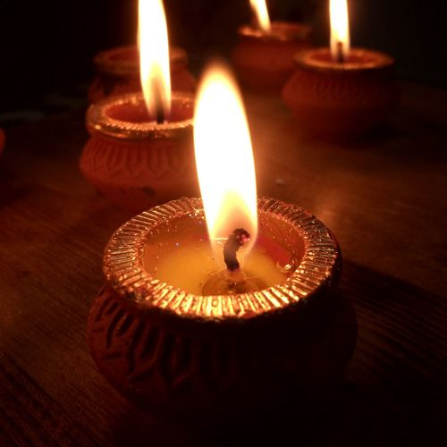 Enlightened Diya - Oil Lamp Illuminated Flame Heat - Temperature Burning Candle Oil Lamp Glowing Close-up Candlelight