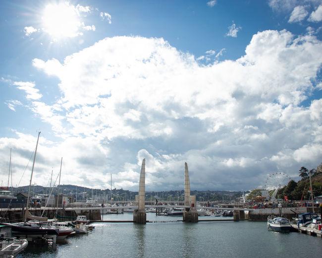 Sailboats moored in bay