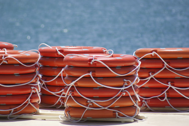 Piles of ordered floats Orange Pier Accumulation Blue Collection Day Floats Heap Lots No People Ordered Objets Outdoors Pile Plastic Ropes Boats Sea Water Waterwings
