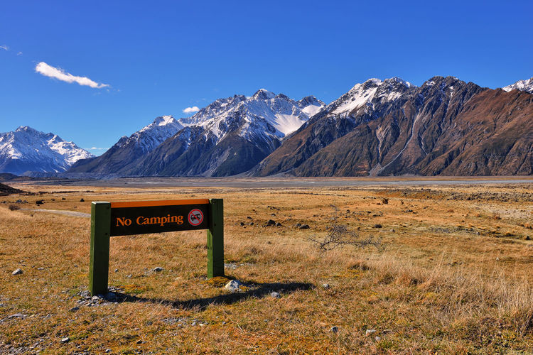 """""""No Camping"""" road sign, Mount Cook National Park, New Zealand Beauty In Nature Galaxy Landscape Mountain Mountain Peak Mountain Range Natural Parkland Nature Night No People Outdoors Scenics Sky Snow Tranquility Winter"""