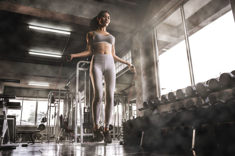 Young Adult Full Length Adult Women One Person Low Angle View Lifestyles Indoors  Young Women Clothing Architecture Real People Casual Clothing Motion Fashion Beauty Standing Beautiful Woman Hairstyle Gym Sexywomen Lose Weight Rope Jumping Exercise Muscle
